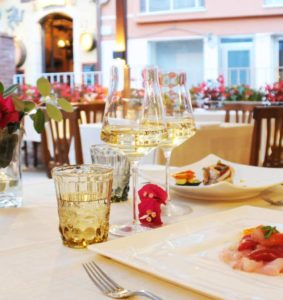 Italian table, with goblets of sicilian white wines